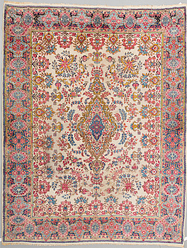 A CARPET, a semi-antique Kerman, ca 354 x 269 cm.