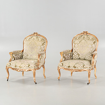 A pair or armchairs in rococo style, made around year 1900.