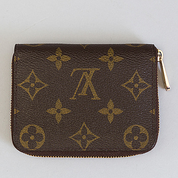LOUIS VUITTON, A wallet by Louis Vuitton.