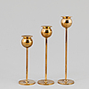 Pierre forssell, a set of three 'tulip' brass candlesticks by skultuna bruk, 1993.