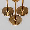Pierre forssell, a set of three 'tulip' brass candlesticks by skultuna bruk, 1993.