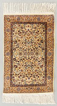 A semiantique Hereke carpet ca 94 x 63 cm.
