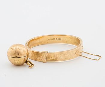 ARMBAND, 18K guld med berlock.