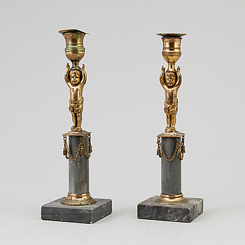 A pair of Swedish late Gustavian brass and marble candlesticks.