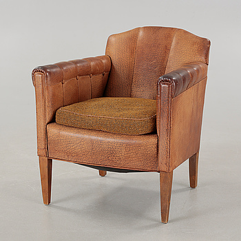 An armchair, made in the first half of the 20th century.