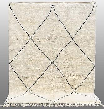 A carpet  Moroccan, around 305 x 222 cm.
