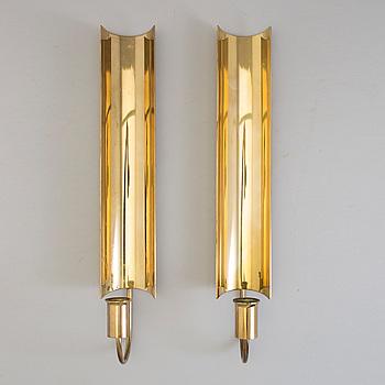 """PIERRE FORSSELL, ljuslampetter, ett par, mässing, """"Reflex"""", Skultuna."""