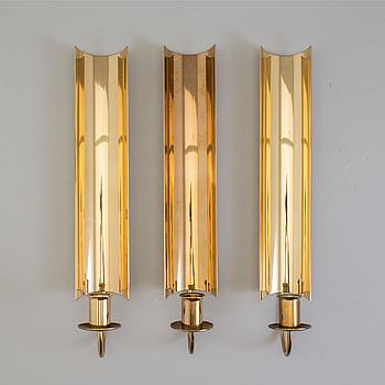 """PIERRE FORSSELL, ljuslampetter, 3 st, mässing, """"Reflex"""", Skultuna."""