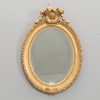 A GUSTAVIAN STYLE WALL MIRROR , EARLY 20TH CENTURY.