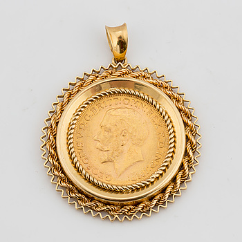 A gold Sovereign coin with George V from 1928.