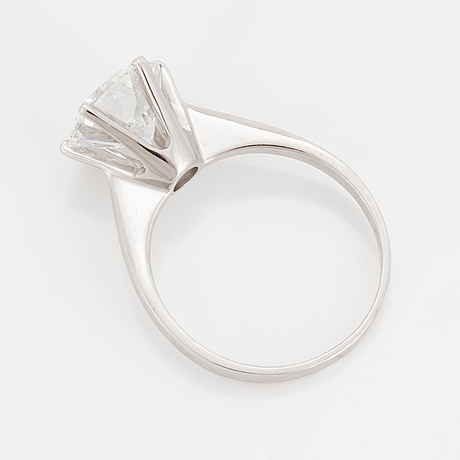 A solitaire ring set with a round brilliant-cut diamond.
