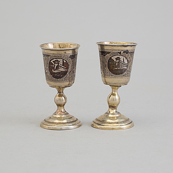 """A pair of Russian 19th century parcel-gilt niello footed vodka cups, makers mark cyrillic """"МД"""" (MD)."""