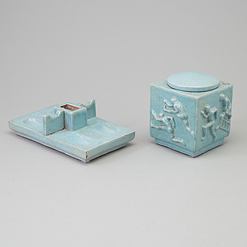 An earthenware lidded jar and an object, first half of the 20th Century.