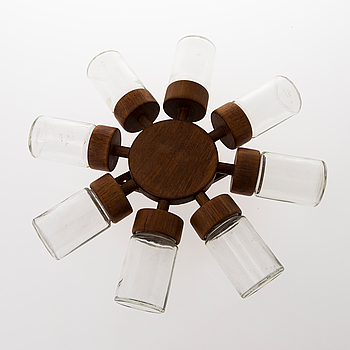 A Danish 1960s wall mounted spice rack in teak and glass from Digsmed.