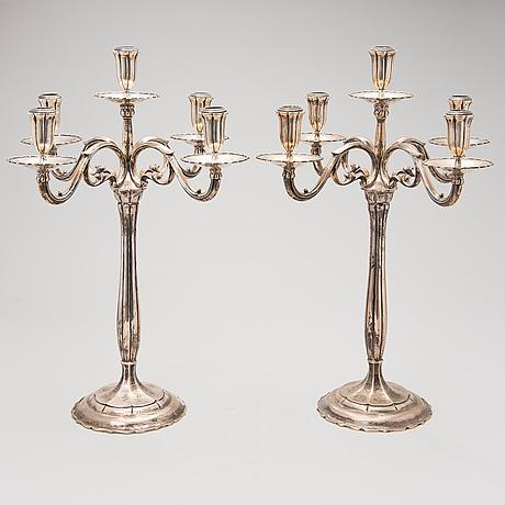 A pair of silver candelabras, finsh import marks helsinki 1926