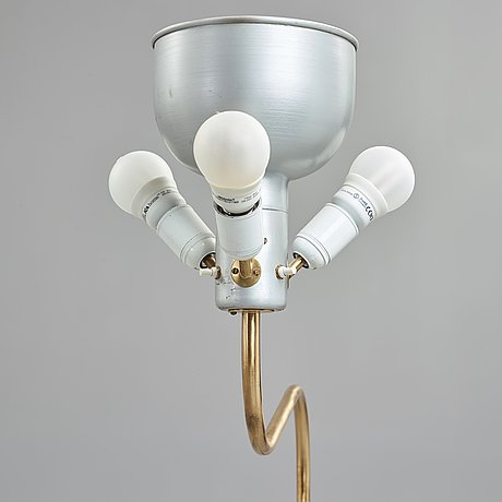 Josef frank, a pair of brass floor lights, svenskt tenn, sweden.