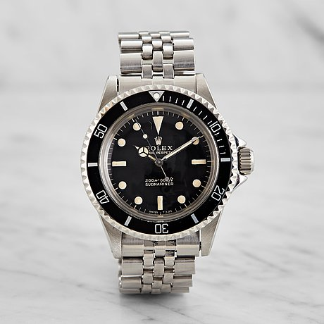 Rolex, submariner, 'meters first, gilt dial'.