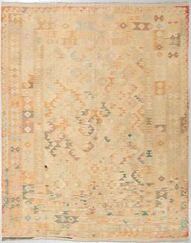 A kelim rug, 305 x 260 cm.