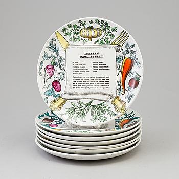 PIERO FORNASETTI, A set of 7 plates by PIERO FORNASETTI, Milano, Italien.