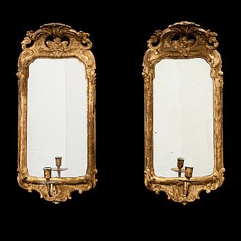 A pair of Swedish Rococo one-light girandole mirrors.