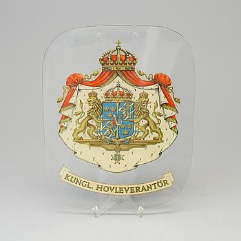 SKYLT, glas, Kunglig Hovleverantör, 1900-talets mitt.