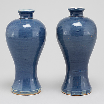 A pair of blue glazed meiping vases, 17th Century.