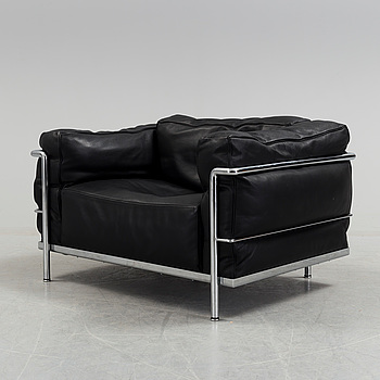 A 'LC3' easy chair by Pierre Jeanneret & Charlotte Perriand, Le Corbusier for Cassina.