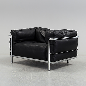 A 'LC3' easy chair by Pierre Jeanneret & Charlotte Perriand. Le Corbusier for Cassina.