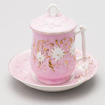 A Russian porcelain chocolate cup and saucer by Kuznetsov, Volkov factory 1893-1917.