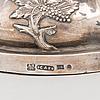 A pair of russian silver candlesticks. st. petersburg, maker's mark cas, assay master at 1850