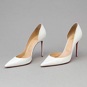 A pair of pumps by CHRISTIAN LOUBOUTIN, in size 40,5.