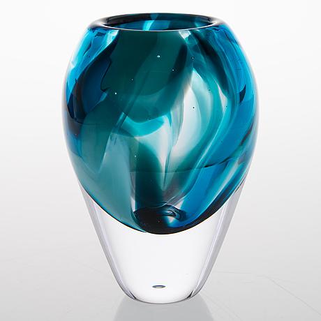 A vase signed sini majuri.
