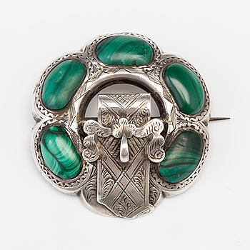 A BROOCH set with malachite.