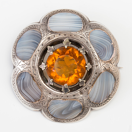 A brooch set with amber coloured paste and agate