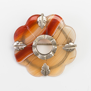 A BROOCH set with banded agate.