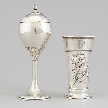 An art nouveau parcel gilt lidded cup and beaker, maker's mark cg hallberg, stockholm 1913 and 1900