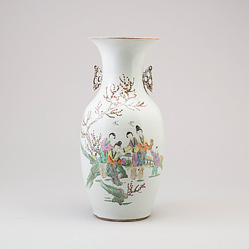 A Chinese 20th century famille rose figural vase.