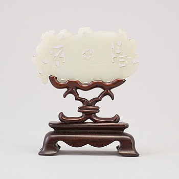 A Chinese nephrite sculpture on stand, 20th century.