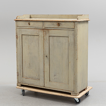 A first half of the 19th century painted cupboard.