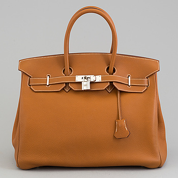 A gold togo Birkin 35 handbag by Hermès from 2004.