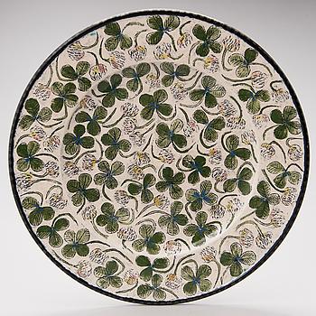 A stoneware decorative dish signed Kaipiainen.