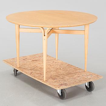 a coffee table from Firma Karl Mathsson, Värnamo, dated 1986.