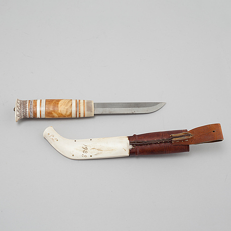 A knife by paul larsson, signed and dated 1988.