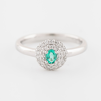 An emerald and brilliant cut diamond ring.