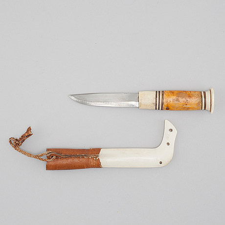 A knife by erik knutsson, signed.
