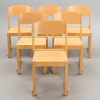 A set of six stackable chairs.