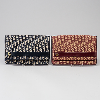 CHRISTIAN DIOR, Two monogram canvas clutches by Christian Dior from the 1980's.