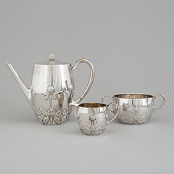 A Danish Arts and crafts sterling silver three piece coffee set, Niels Georg Henriksen for A. Michelsen, 1906 and 1921.