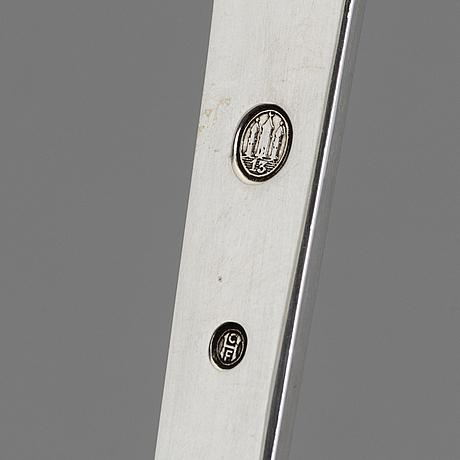 A two piece danish art nouveau silver serving set, design thorvald bindesbøll, maker's mark rasmus jensen, horsens 1913
