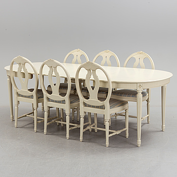 A gustavian style dining table and six chairs, second half of the 20th century.
